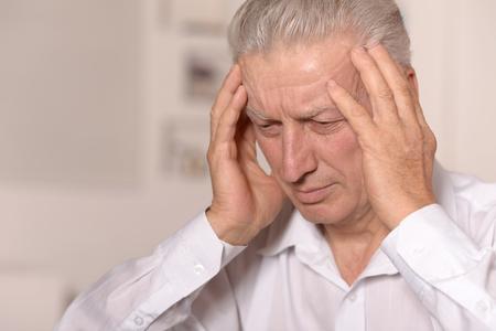 older age: Thinking senior man at home