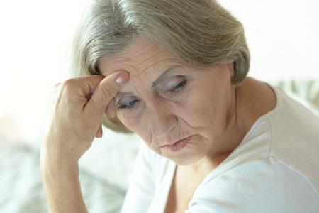 Portrait of thoughtful sad elderly woman photo