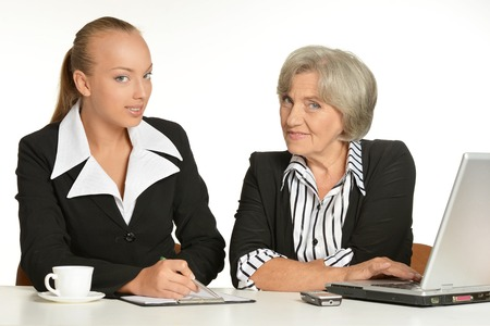 collegue: Young manager and her elderly collegue have a talk in office
