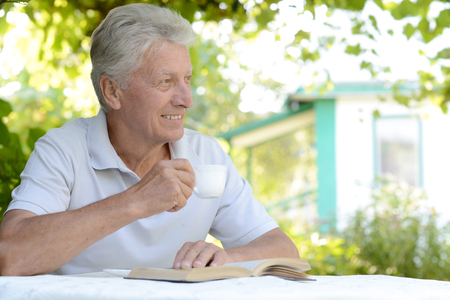 financial official: Portrait of a man reading a book at nature
