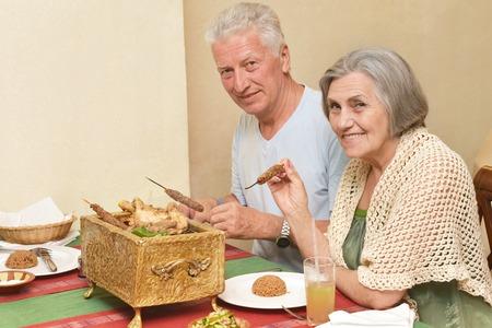 Senior couple having a dinner at restaurant photo