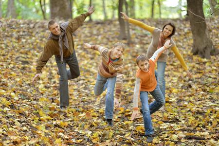 jungle boy: Happy family having fun in autumn forest Stock Photo