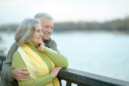 Happy senior couple relaxing in autumn park