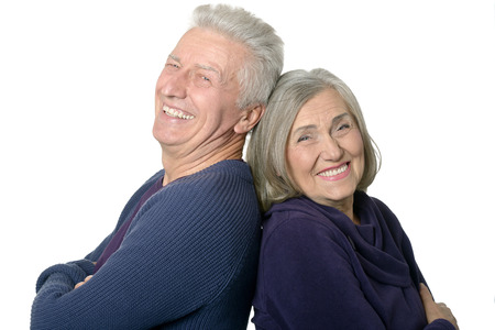 old lady: Happy smiling old couple on white background Stock Photo