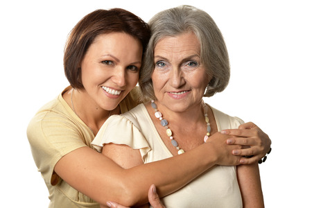 mamma: Portrait of Senior woman with daughter on a white background
