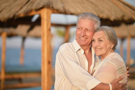 Happy Mature couple on beach near sea Standard-Bild