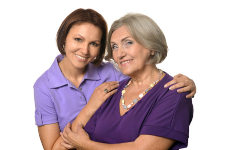 Portrait of Senior woman with daughter on white background Фото со стока