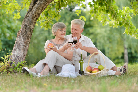 family portrait: loving elder couple spending time together outdoors
