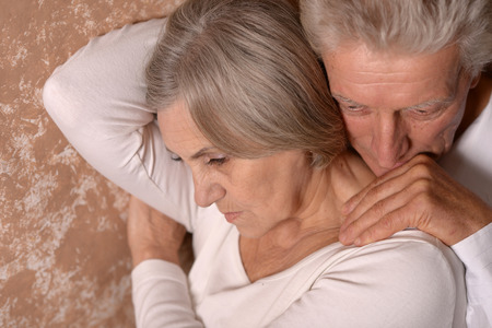 female senior adults: Sad Senior couple at home Stock Photo