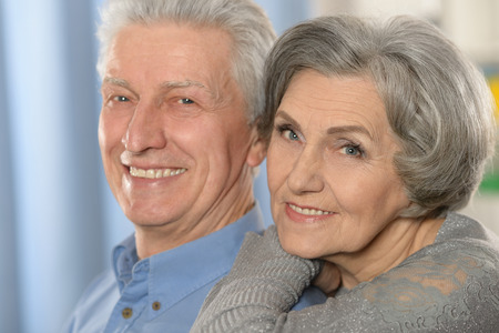 Portrait of a happy senior couple at home Stock Photo