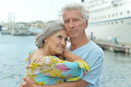 Senior couple standing on pier