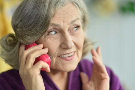 Portrait of an elderly woman with phone Stock Photo