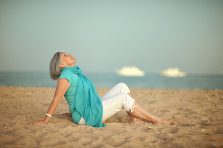 Happy mature woman on beach