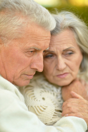Portrait of a sad elder couple outdoor photo