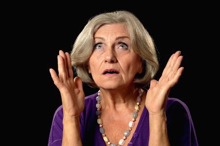 lamentable: Portrait of an elderly woman  on a black background