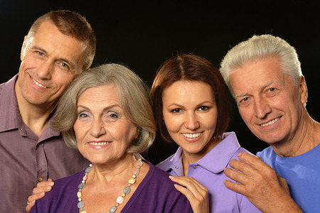 daughter in law: Portrait of a cute family portrait with senior parents