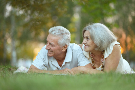 Beautiful happy old people in the park photo