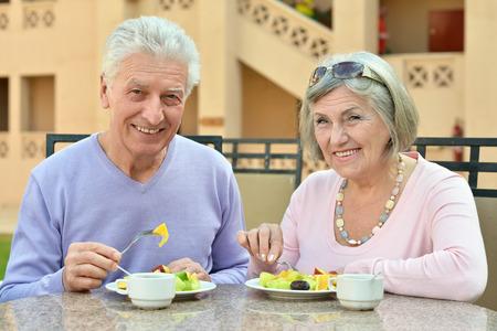 Happy Senior couple having breakfast in cafe photo