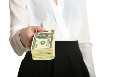 woman holding money: Woman holding money on a white background