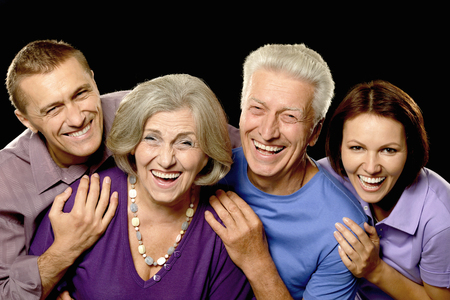 father in law: Portrait of a  cute family portrait with senior parents Stock Photo