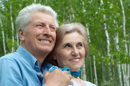 smilling: Elderly couple smilling together over natural background Stock Photo