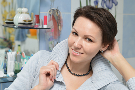 primp: attractive young woman preening front of a mirror Stock Photo