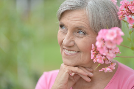 Portrait of Older woman with pink flowers