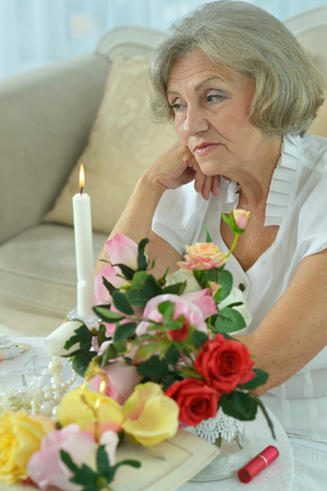 beautiful senior woman crying in the room photo