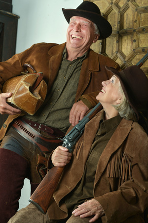 hunter's: Two smiling hunters in western clothes, closeup