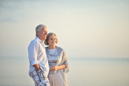 Portrait of a happy mature couple relaxing on beach
