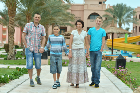 mam: Portrait of a happy family at tropical resort.