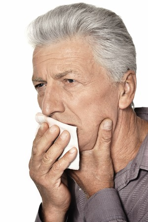 old man standing: Sick old man standing on white background Stock Photo