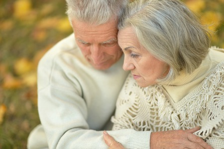 old couple: Portrait of a sad elder couple outdoor Stock Photo