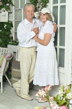 village house: Portrait of beautiful elderly couple on veranda