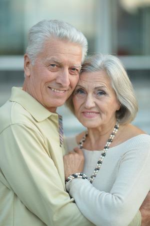 active life: Happy mature couple near wall on street Stock Photo