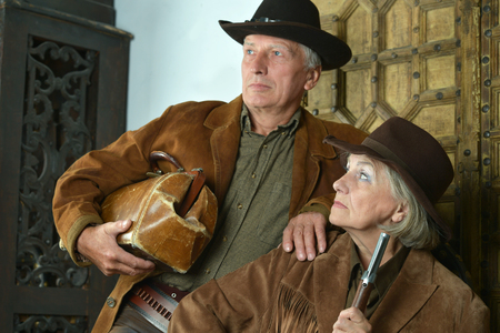 bandits: Two mature bandits with guns in the wild west Stock Photo