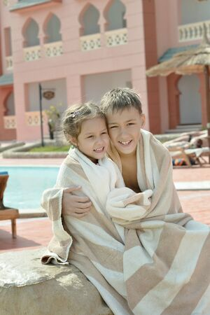 good looking teenage guy: Portrait of wet Brother and Sister on vacation resort ovre pool
