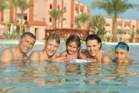 Portrait of a happy family relax in the pool photo