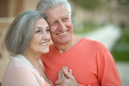 hugging couple: Portrait of a happy senior couple in rest Stock Photo