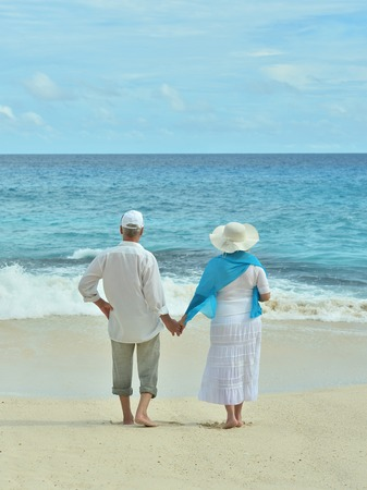 old couple: Beautiful happy elderly couple rest at tropical resort