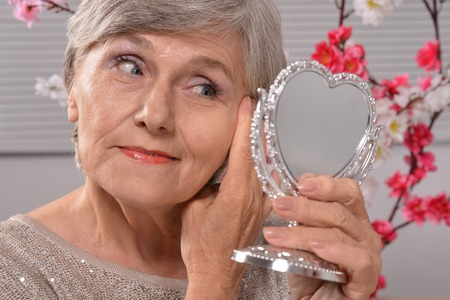 portrait of an elderly woman with mirror Stock Photo