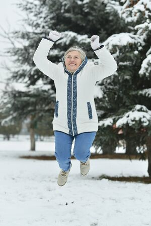 woman fur: Portrait of a beautiful old woman jump in the winter