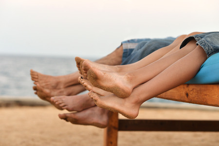 Portrait of a family feet on beach background