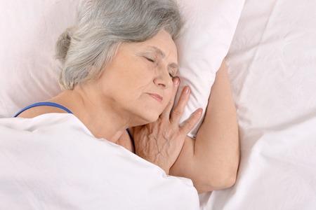 Beautiful older woman sleeping in the bedroom