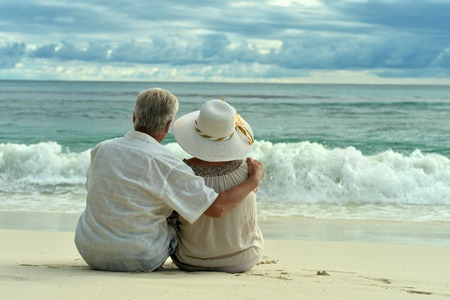 male senior adult: Beautiful happy elderly couple rest at tropical resort