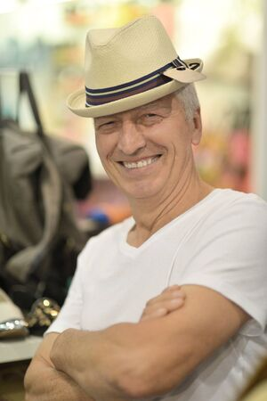 good grooming: Portrait of a nice mature man in hat Stock Photo