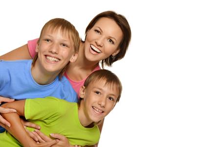 mam: Happy family of four on white background Stock Photo
