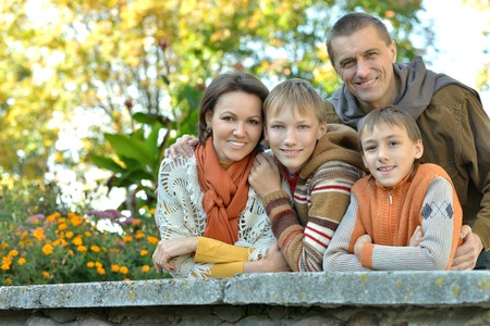 kid portrait: Portrait of family relaxing in autumn park Stock Photo