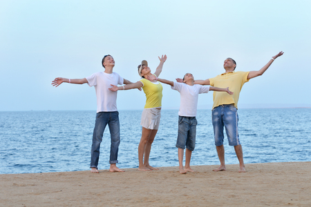 mam: Portrait of a happy family at beach  in summer