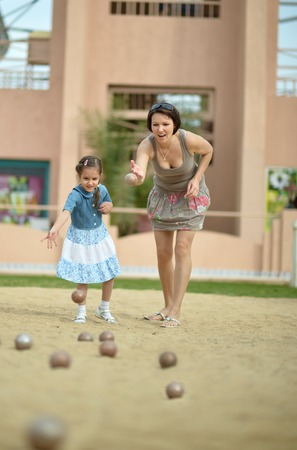 boules: Mother and daughter playing Boules game  on tropical resort